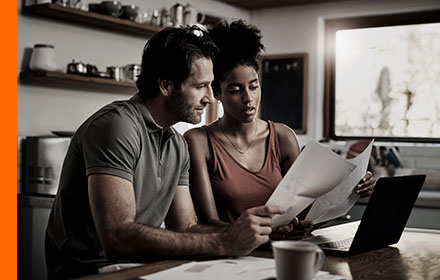 A man and a woman looking at some paperwork